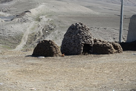 Dung as fuel, stacked to form a walk-in hut. Photo: KW.