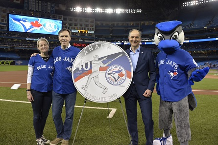 From left: Royal Canadian Mint CEO Sandra Hanington, Minister of Finance Bill Morneau and Robert Witchel, Executive Director of Jays Care Foundation unveil a new silver collector coin at Rogers Centre to celebrate the 40th season of the Toronto Blue Jays.