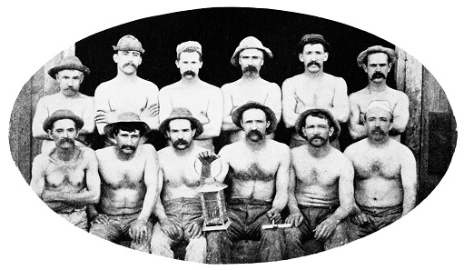 Miners of the Gould and Curry Mine. Because of the intense heat deep down, they do not wear any outer garments. Source: Wikipedia.