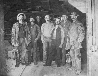 Seven miners of the Comstock Lode. The image's original caption read: To Labor is to Pray. Source: Wikipedia.