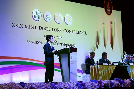 Dr Bo Deng presents a machine developed for the visual checking of large quantities of commemorative coins. Photograph: Mint of Thailand.