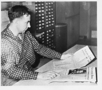 Chet compares the first issue of his Numismatic News with the one dating from January 5, 1959. Photograph: Krause Publications.
