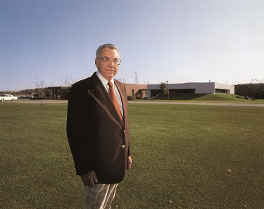 Chet Krause in front of his new business premises in the mid-1980s. Photograph: Krause Publications.