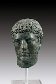 Lot 6a: Severan male portrait. Roman Imperial times, early 3rd century AD. Hollow bronze cast, H. 28 cm. Superb dark-green patina, broken at the neck, most of the face missing. From the stock of Ancient and Medieval Art, Furneux, Pelham, which closed down in 1990. Gorny & Mosch 210 (2012), 13A. Estimate: 30,000,- euros. Hammer price: 60,000,- euros.