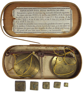 Lot 637: Spain. Early 19th century. Scale and weights. Balance scale with pans. Includes five brass weights: 1 ounce, 1/2 ounce, 1/4 ounce, 1/8 ounce, and 1/16 ounce. All housed in an ovoid wooden case with paper explanation on underside of lid. Estimate: $200.