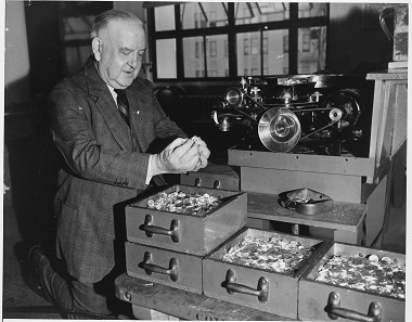 Peter J. Haggerty, the then Superintendent of the Mint, examining a part of the production for China. Photograph: National Archives and Records Administration 296602.