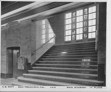 Staircase to the first floor with an elaborate glass window depicting the working steps involved in coin minting. Photograph: National Archive, Gray Brechin has brought this picture to our attention.