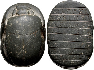 Lot 683: 3rd Intermediate Period. 1069-664 BC. Green stone (siliciclastic indurated stone) heart scarab (55x38mm) quoting Spell 30B from the Book of the Dead. From the Carl Devries Collection. Estimate: $1000.