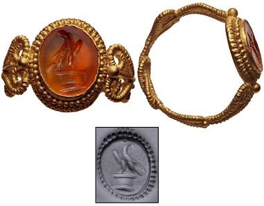 Lot 930: Gold finger ring with orange garnet intaglio. Roman, 3rd-4th centuries AD. Estimate: 1,500 USD.