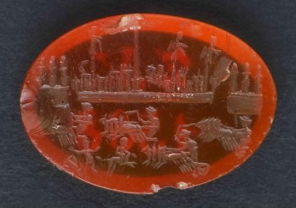 Wagenrennen im Circus Maximus, 1. Jahrhundert n. Chr. Honigfarbener Karneol. Foto: © Stiftung Schloss Friedenstein Gotha, Lutz Ebhardt.