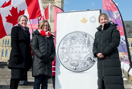 From left: Royal Canadian Mint CEO Sandra Hanington, Minister of Democratic Institutions Karina Gould and Minister of Canadian Heritage Mélanie Joly unveil a new silver collector coin celebrating Canada 150.