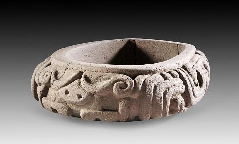 Lot 600: Stone yoke. Veracruz, AD 250-450. L ca. 45 cm, W ca. 33 cm. Grey basalt. From the Prof. Dr. Günther Marschall Collection, Hamburg. Acquired 1967-1975. Estimate: 6,000,- euros.