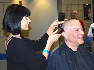 "Professional stylist ""Dava"" skillfully removed Heritage Auctions Co-Chairman Jim Halperin's hair to help raise $10,000 for the ANA and the Standish Foundation for Child & Family Centered Healthcare. Photo credit: Donn Pearlman."