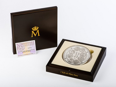 The coin comes in a wooden case with a booklet on the history of the dollar.