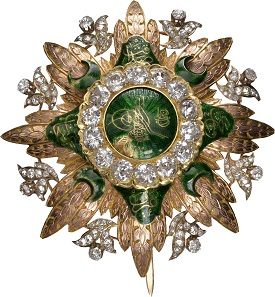 Lot 7176: High Order of Distinction. Breast Star, variant with diamonds in medallion ring. From the Ottoman Collection. RRRR. II. Estimate: 50,000,- euros.