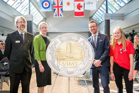 From left: Military Museums Senior Curator Rory Cory, Royal Canadian Mint President and CEO Sandra Hanington, Vimy Foundation Executive Director Jeremy Diamond and Bishop Carroll High School Student Rachel Barlow unveil a $2 circulation coin commemorating the 100th anniversary of the Battle of Vimy Ridge at the Military Museums in Calgary, AB (October 5, 2017).