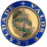 An insignia for Valour and Loyalty (left) based on a Mediaeval coin (right), an espadim of King Alphonsus V, circa 1458.