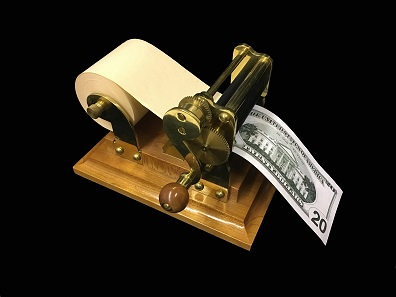 Owen Supreme Magic Money Machine, a conjuring prop that seemingly transforms a blank roll of paper into banknotes. © the Magic Circle