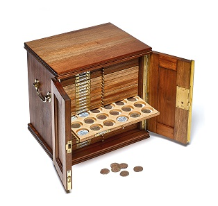 Coin cabinet containing silver shillings of Henry VIII. © the Trustees of the British Museum