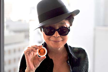 Yoko Ono presenting the one-off strike of a John Lennon coin in 22 carat gold.