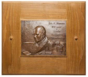 The portrait plaque in memory of Eric Pfeiffer Newman's 100th birthday.