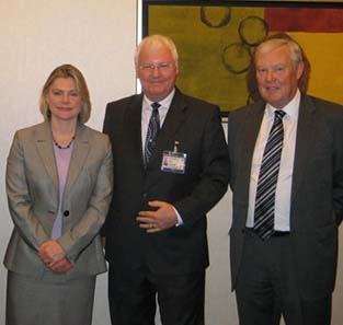 Keynote speaker Justine Greening, MP and Economic Secretary to the UK Treasury (left ) with Richard Haycock, Coin Conference Chairman (centre) and Mike Davis, Chairman of the Royal Mint, honorary sponsors of the Coin Conference (right).
