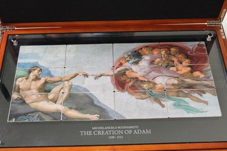 """Sammlung von Silberbarren aus Niue zum Thema """"The Creation of Adam"""" aus der Serie Giants of Arts."""