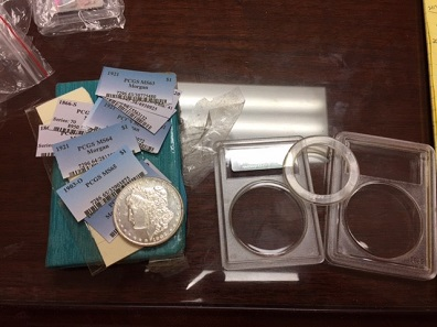 Counterfeit Morgan dollar as well as counterfeit PCGS inserts and components of fake PCGS holder are among seized items sized by Homeland Special Investigates division of Homeland Security.