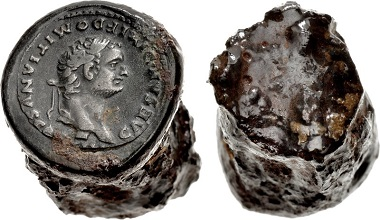 Lot 754: Counterfeiters' Hubs. temp. Domitian. As Caesar, AD 69-81. Bronze counterfeiter's obverse hub for denarius set in iron shank (20x29mm, 47.43 g). Manufactured circa AD 80 or later. Dimensions: overall length, 29mm; diameter, 19 mm at face, tapering to 17mm at base. Of cylindrical form. Weight: 46.02 grams. Cast of denarius of Domitian, showing obverse with legend CAESAR DIVI F DOMITIANVS COS VII, mounted to iron shank. Cf. RIC II 266 (for coin). Good VF, some rust and deposits. Extremely rare. Estimate: $3,000.
