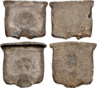 Lot 757: Counterfeiters' Molds. temp. Valens. AD 364-378. Lead Counterfeiter's Mold for AR Siliqua. Dimensions: overall dimensions of each section, approximately 49x47x5mm with 54mm at point of connection. Total weight: 261.620 grams. Two lead plates designed for casting, each with impression of one side of a Trier mint siliqua of Valens (cf. RIC IX 27e2). Intact, earthen patina and traces of deposits. Extremely rare. Estimate: $7,500.