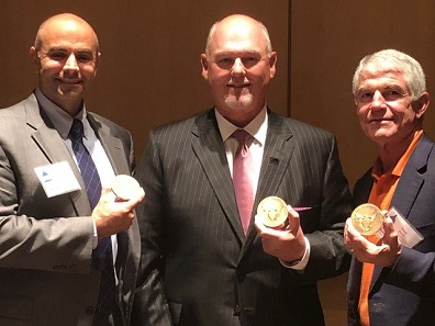 Homeland Security Investigations Special Agent Nicholas L. Tranchitella, Delaware Valley Rare Coins President Richard Weaver, and NCIC President Doug Davis were awarded ACTF's 2018 Al Kreuzer Memorial Award for outstanding work in combating counterfeiters and those who traffic in counterfeit coins and currency in the United States. (ICTA image by David Crenshaw).