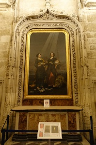 """Find the Goya"" is a popular game in Spanish cathedrals. And there it is: depicting Santa Justa (like the train station) and Santa Rufina. Photo: KW."