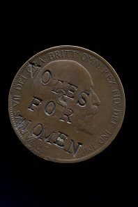 "Edward VII penny, 1903, defaced with the slogan ""Votes for Women"". © The Trustees of the British Museum."