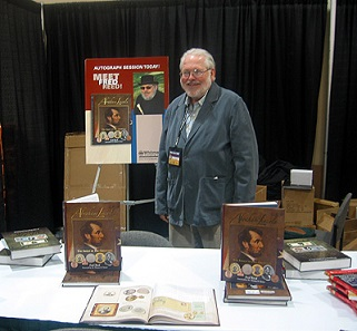 Fred L. Reed with his first book on Abraham Lincoln in numismatics, Abraham Lincoln: The Image of His Greatness, at the 2010 ANA World's Fair of Money.
