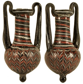 Lot 641: Glass amphoriskos. Hellenistic, 3rd-1st centuries BC. Height: 8.1cm. Small loss on neck. Repaired. Estimate: $300.