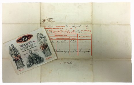 Lot 5293. 10 guldens 1858 (counterfeit and original) and envelope.