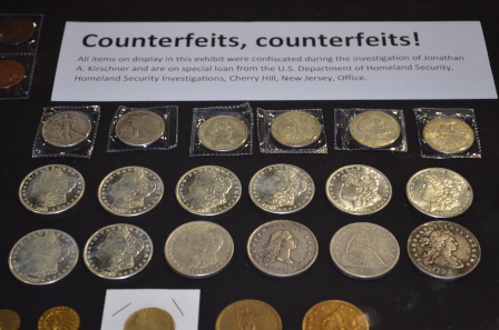 A portion of the exhibit of confiscated counterfeits on special loan from the Department of Homeland Security displayed at the 2018 World's Fair of Money® by ICTA/ACTF.
