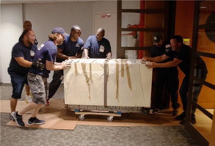 Moving one of the cabinets weighing almost 1,000 pounds into the ANS.
