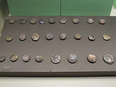 Some Bronze coins from sepulchral finds. Photograph: KW.