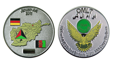 German soldiers, who were part of the Operational Mentoring and Liaison Team (OMLT), had this coin minted to mark their deployment in 2011. The obverse features the deployment time, a map of Afghanistan including the deployment location Kunduz, the German and Afghan flag, as well as the emblem of the Afghan National Army. The reverse depicts a common OMLT badge. Photo: DerTaler.de
