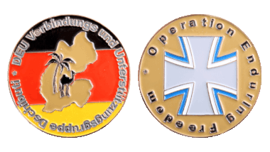 The Deutsche Verbindungs- und Unterstützungsgruppe in Djibouti has been assigned to serve at the Horn of Africa as part of Operation Enduring Freedom. One of their Challenge Coins features the national colors of Germany, the name of the task force, the outline of Djibouti as well as a camel and a palm tree. On the reverse, we can see the logo of the German Navy and the name of the NATO operation. The medal's color is reminiscent of the country's desert landscape. Photo: DerTaler.de