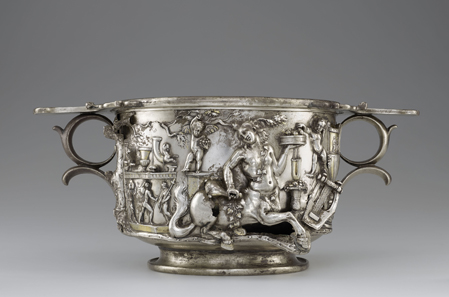 "Cup with Centaurs and Cupids. Roman, 1-100 CE. Inscription: ""MERCVRIO AVGVSTO Q DOMITIVS TVTVS EX VOTO"" (To Augustan Mercury, Quintus Domitius Tutus in fulfillment of a vow). Find-spot: Berthouville, France. Silver and gold, H. 11.7 cm; W. 26.8 cm; D. 17.4 cm. Bibliothèque nationale de France, Paris: Inv. 56.7. Photo: Tahnee Cracchiola © Getty-BnF."