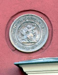 Medaille an der Hauswand Obermarkt 126. Foto: Privatarchiv numiscontrol.