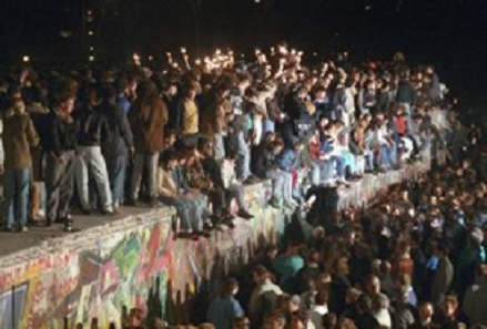 A photo of people who climbed the Berlin Wall on November 9, 1989.