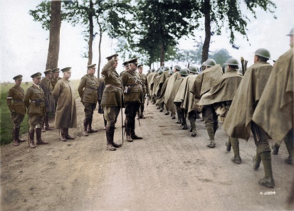 General Mewburn and Lieutenant-General Currie with marching soldiers, August 1918. Image colourized by Canadian Colour. Photo: George Metcalf Archival Collection, Canadian War Museum.