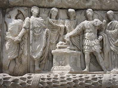 Detail of the Arch of Galerius: sacrifice within the family circle. Photograph: KW