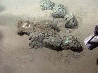 Odyssey discovered hundreds of silver coin concretions lying on the seabed at the