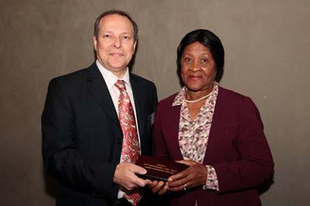 (left to right): An important part of South African history, Alan Demby, the executive chairman of The South African Gold Coin Exchange (SAGCE) presents Mrs Albertina Luthuli, daughter of Chief Albert Luthuli, with the Mandela Luthuli Laureate twin set that will be put on permanent display at the Luthuli Museum.