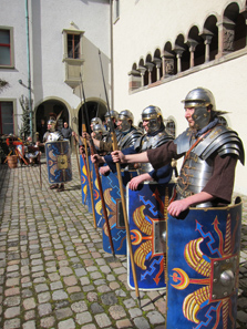 Roman soldiers in the mediaeval abbey courtyard. Photo: UK.