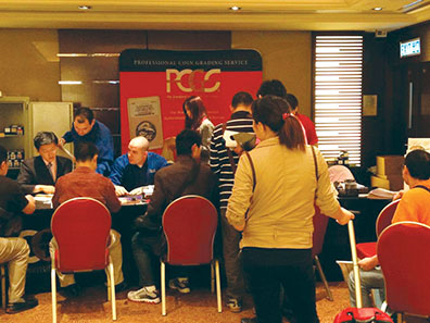 The PCGS booth was busy during the April 2012 Hong Kong International Coin Convention & Antique Watch Fair. Photo: PCGS.